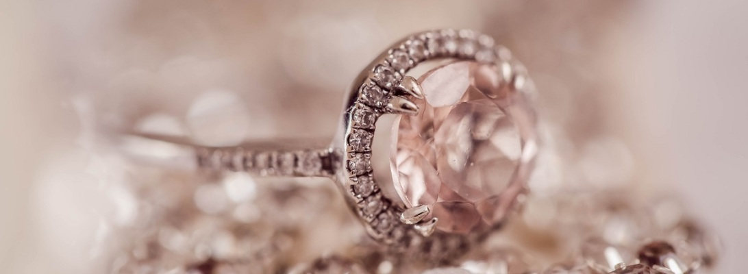 Diamond wedding ring surrounded by more diamonds